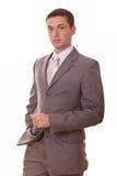 Mann in der grauen Klage Stockfoto