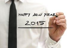 Mann, der guten Rutsch ins Neue Jahr 2015 schreibt Stockbild