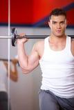 Mann an der Gymnastik Stockbilder