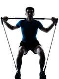 Mann, der gymstick Trainings-Eignungslage ausübt Lizenzfreie Stockfotografie