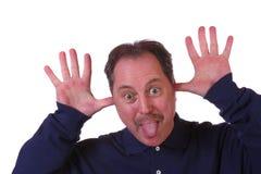 Mann, der heraus Zunge haftet Stockbild