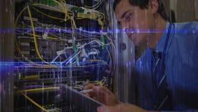 Mann, der im Server-Raum und in den blauen Matrixdaten arbeitet stock video footage