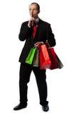Mann in der Klage mit Einkaufenbeuteln Stockfotos