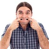 Mann, der lustiges Gesicht bildet Stockbilder