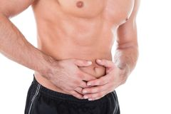 Mann, der Magenschmerzen hat Stockfoto