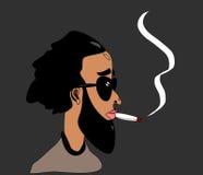 Mann, der medizinisches Marihuana raucht Stockfotografie