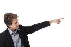 Mann, der mit seinem Finger zeigt Stockfotografie