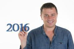 Mann, der 2016 mit seinem Finger zeigt Stockfotografie