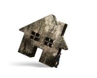 Mann, der schmutziges konkretes Haus hält Lizenzfreies Stockfoto