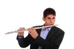 Mann, der seine Flöte spielt. Lizenzfreies Stockbild