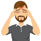 Mann, der seine Tempel erleiden Kopfschmerzen berührt Lizenzfreies Stockfoto