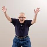 Mann, der seinem Erfolg zujubelt und feiert Lizenzfreies Stockfoto