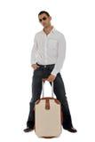 Mann, der seinen Carry-on anhält Lizenzfreie Stockbilder