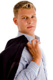 Mann, der seinen Mantel anhält Lizenzfreie Stockfotos