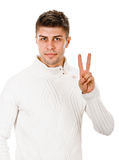 Mann, der Siegeszeichen zeigt Lizenzfreie Stockfotografie