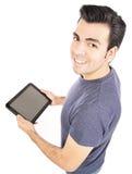 Mann, der Tablet-Computer oder iPad verwendet Stockfotografie