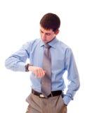 Mann, der Uhr betrachtet Stockfotografie