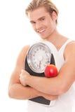Mann, der um seinem Gewicht sich kümmert stockfotos