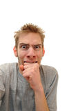 Mann, der unten an Hand beißt Lizenzfreie Stockbilder