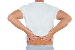 Mann, der unter niedrigeren Rückenschmerzen leidet Lizenzfreie Stockbilder