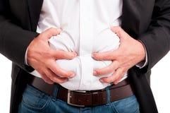 Mann, der Verdauungsstörung nach einem Business-Lunch hat Stockfotografie