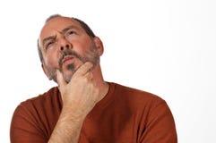 Mann, der verdutzt schaut Lizenzfreies Stockbild