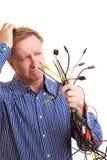 Mann, der viele verschiedenen Seilzüge anhält Stockfotos