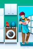Mann, der Wäscherei tut Stockbild