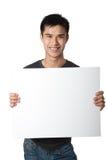 Mann, der weißes Zeichen anhält Lizenzfreie Stockbilder