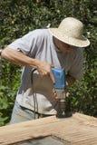 Mann durch Arbeit Lizenzfreie Stockbilder