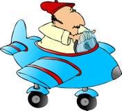 Mann in einem Spielzeugflugzeug Stockfotografie