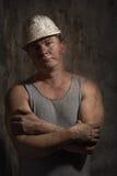 Mann in einem Sturzhelmbergmann Stockfoto