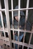 Mann in einer Zelle lizenzfreie stockfotografie
