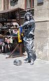 Mann eingefroren als Skulptur in der historischen Mitte von Lemberg Lizenzfreies Stockbild