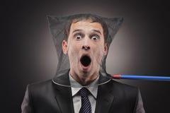 Mann eingeschlossen in einem Basisrecheneinheitsnetz Stockbild