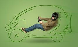 Mann fährt ein eco friendy elektrische Hand gezeichnetes Auto Stockfotografie