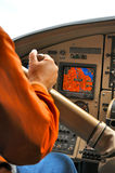 Mann in floatplane Cockpit Stockfotografie
