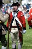 Mann gekleidet als britischer Redcoat Stockbild