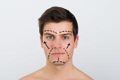 Mann-Gesicht mit Perforationslinien stockfotos