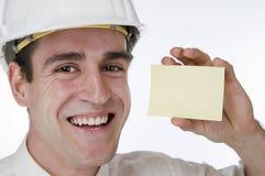 Mann glücklich mit Karte auf Weiß Lizenzfreie Stockfotografie