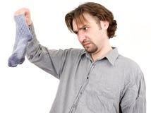 Mann hält Socken Lizenzfreie Stockbilder