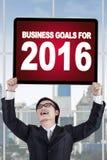Mann hält Unternehmensziele für 2016 Lizenzfreies Stockbild