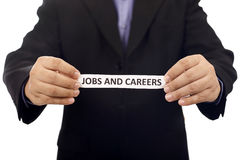 Mann halten Papier mit Jobs und Karriere-Text Lizenzfreie Stockbilder