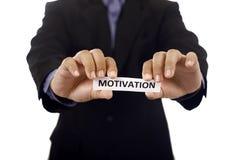 Mann halten Papier mit Motivations-Text Stockbild