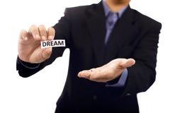 Mann halten Papier mit Traumtext Lizenzfreies Stockbild