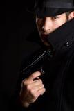 Mann-Holding-Gewehr Stockfotografie