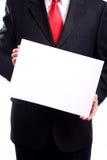Mann-Holding-Zeichen Stockbild