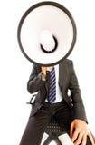Mann im Anzug mit Megaphon Stockbild