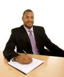 Mann im Anzug-Schreiben im Notizbuch Lizenzfreies Stockfoto