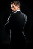 Mann im eleganten schwarzen Anzug stockbilder